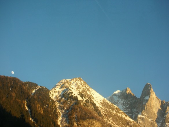 Setting sun with moon above the mountains, Chamonix